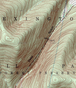 "A topographic map with brown contour lines on a green background showing a steep cleft with a road at its bottom. The words ""Deep Notch"" run along the road"