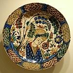 Dish with youth in landscape setting, Kubatchi ware, Northwestern Iran, Safavid period, early 17th century, earthenware with underglaze polychrome painting - Cincinnati Art Museum - DSC04117.JPG