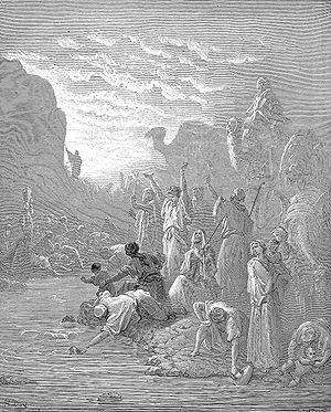 "Mount Horeb - Moses Striking the Rock at Horeb, engraving by Gustave Doré from ""La Sainte Bible"", 1865"