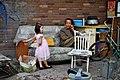 Downtown Tianjin, girl in furniture garage.jpg