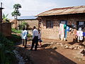 Drainage channel, solid waste heap and footpath in Kamokya, Kampala (4331538683).jpg