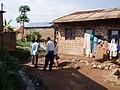 Drainage channel, solid waste heap and footpath in Kamokya, Kampala (4331538683).jpg