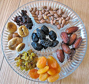 English: Dried fruit and nuts on a platter, tr...