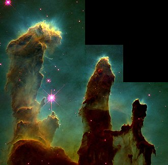 "Open cluster - The so-called ""Pillars of Creation"", a region of the Eagle Nebula where the molecular cloud is being evaporated by young, massive stars"