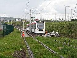 Edinburgh tram approaching the end of the line (geograph 3093368).jpg