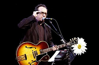 Elvis Costello - Elvis Costello performing at a Promotional concert (Summer 2006)