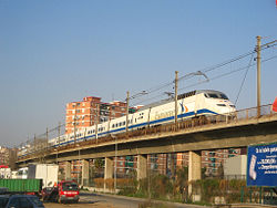 Euromed on viaduct through cityscape.jpg