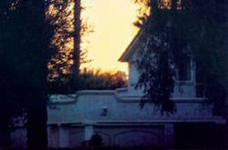 Color temperature - The house above appears a light cream during midday, but seems to be bluish white here in the dim light before full sunrise. Note the color temperature of the sunrise in the background.