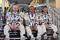 Expedition 38 backup crew members in front of the Soyuz TMA spacecraft mock-up in Star City, Russia.jpg