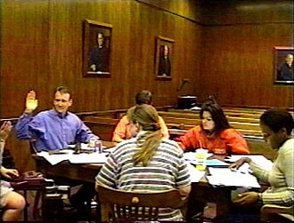 Deposition (law) - Expert witness deposition in a mock trial simulation. The court reporter, who is an officer of the court, administers the oath to the deponent.