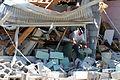 FEMA - 43905 - Mississippi Tornado Survivor at Wrecked Building.jpg