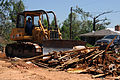 FEMA - 44111 - Volunteer Clears Storm Debris with construction equipment in Mississippi.jpg