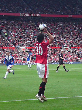 Fábio taking a throw-in for Manchester United against Birmingham City