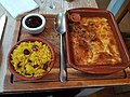 Falmouth, Cornwall - Bobotie (Lightly spiced mutton, almonds and raisins with a baked egg and cream topping) served with raisin rice and chutney.jpg