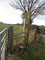 Field edge over a stile - geograph.org.uk - 1102227.jpg