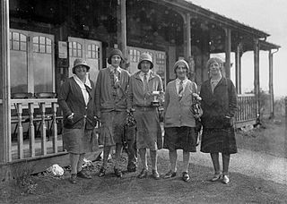 Five lady golfers outside Llandrindod Wells Golf Club pavilion