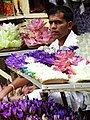 Flower Vendor outside Temple of the Tooth - Kandy - Sri Lanka (14136192095).jpg