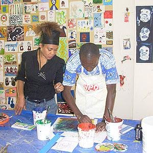 Art therapy - An art therapist watches over a person with mental health problems during an art therapy workshop in Senegal.