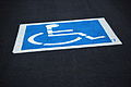 Free Freshly Painted Handicap Wheelchair Parking Sign in Parking Lot Creative Commons (5657947214).jpg