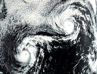 1974 Pacific hurricane season - Hurricanes Ione (left) and Kirsten (right) undergoing a Fujiwhara interaction in August 1974