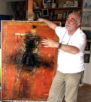 "Gia Gugushvili - Gia Gugushvili with his painting ""Eastern Melody"". Photo by Mikhail Evstafiev"