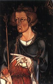 A pale, brown-haired man holding a sceptre and wearing a crown. He is clothed in a black and robe over a white shirt, and is wearing pale gloves