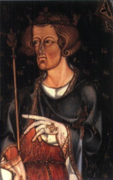 Half figure of Edward facing left with short, curly hair and a hint of beard. He wears a coronet and holds a sceptre in his right hand. He has a blue robe over a red tunic, and his hands are covered by white, embroidered gloves. His left hand seems to be pointing left, to something outside the picture.