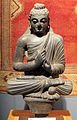 Gandhara, buddha seduto in scisto grigio, 37x10x66 cm, II-III sec. dc..JPG