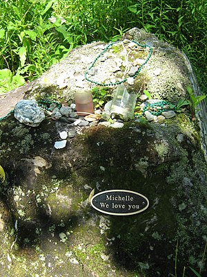 "Murder of Michelle Gardner-Quinn - ""Michelle We love you"" Roadside plaque near where Michelle's body was found. Visitors leave tokens such as beads and flowers on the boulder."