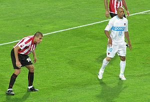 2009 FIFA Club World Cup - Denilson of Pohang Steelers (right) during their semi-final against Estudiantes