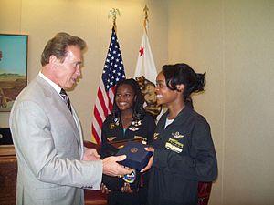 Kimberly Anyadike - Anyadike (center) and sister Kelly meet California Governor Arnold Schwarzenegger.