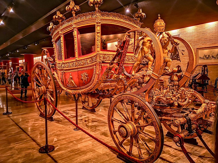 """The Grand Gala Berlin"" is a luxury carriage constructed in Rome during the first half of the nineteenth century. It is the work of two pontiffs: Leo XII, who called for it to be produced in the years 1824-1826, and Gregory XVI, who requested some important modifications. Grand Gala Berlin.jpg"