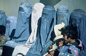 Burqa - Afghan women wait outside a USAID-supported health care clinic.