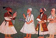 Guru Gobind Singh (with bird) encounters Guru Nanak Dev. An 18th century painting of an imaginary meeting.