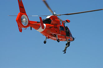Eurocopter HH-65 Dolphin - Members of USCG Air Station Savannah use a USCG HH-65C demonstrating a helicopter rescue