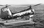 HUP-2 of HU-2 over USS Antietam (CVS-36) in 1955.jpg