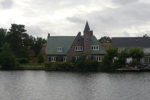 "Johannes Bernardus van Loghem - His house called ""Steenhaag"" on the Spaarne, with the facades of Tuinwijk Zuid behind it"