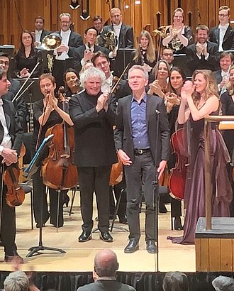 Hans Abrahamsen - Abrahamsen taking a bow with Simon Rattle and Barbara Hannigan after a performance of let me tell you by the London Symphony Orchestra in January 2019