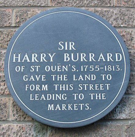 Harry Burrard inherited land in Saint Helier and enabled the construction of a road Harry Burrard plaque Jersey.jpg