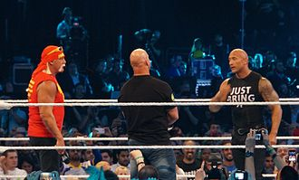 WrestleMania XXX - The pay-per-view began with Hulk Hogan (left), Stone Cold Steve Austin (back turned) and The Rock sharing the ring.