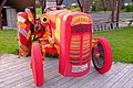 Home-knitted protective cover for old tractor.jpg