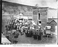 Horses and wagons loaded with goods in front of Wilson's freightering service, Dawson, Yukon Territory, 1900 (AL+CA 2752).jpg
