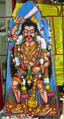Iconic representation of Madan in a village shrine in South India.png