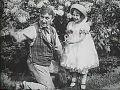 In a garden (1912).jpg