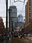 Inbound train at BU Central with Boston skyline, March 2013.jpg