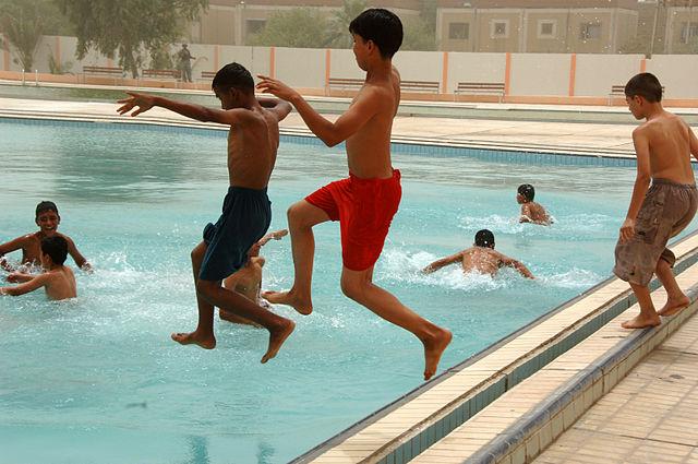 File Iraqi Children Jump Into The Al Jadida Public Swimming Pool After Its Ribbon Cutting