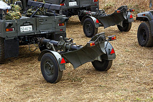 Mortier 120mm Rayé Tracté Modèle F1 - Image: JGSDF 120mm mortar RT transport(20080113)