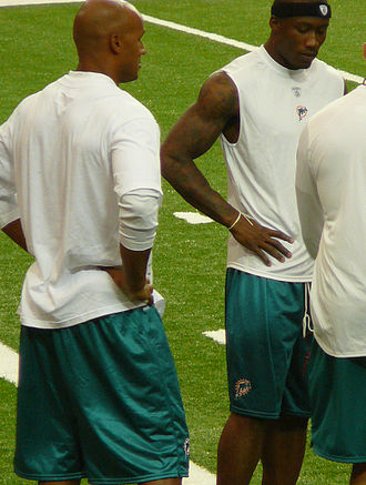 Jason Taylor (American football) - Taylor (left) with Dolphins wide receiver Brandon Marshall in 2011