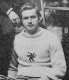 Man in hockey sweater with logo on chest