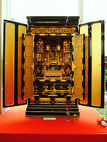 An Ornate Butsudan With Open Doors Displaying An Enshrined Amida Buddha. A  Butsudan In The Jodo Shinshu Buddhism Tradition.